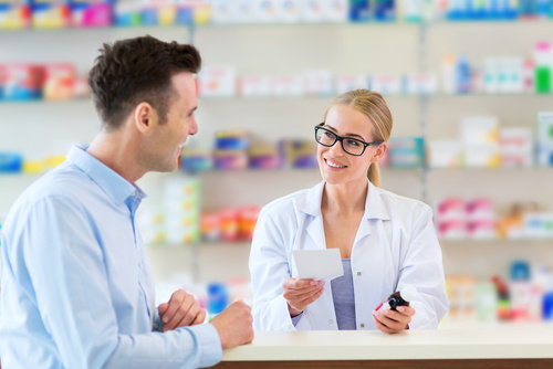 Pharmacist and client at pharmacy